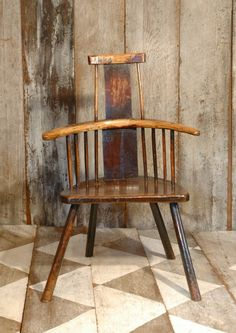A primitive chair as a Sculpture in wood.