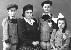 Portrait of members of a Hungarian Jewish family. They were deported to and killed in Auschwitz soon after this photo was taken. Kapuvar, Hungary, June 8, 1944.