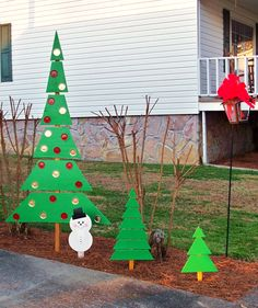 Scrap wood Christmas trees decorated with spray painted Mason jar lids.