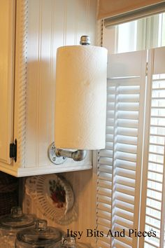 Beyond Clever ! DIY::Easy Cabinet mounted paper towel holder!