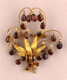 Gold Hair Ornament Set With Briolette-Cut Garnet Drops And Pearls Hung From Eight Gold Volutes Set Behind A Rose Gold Ribbon Which Is Also Mounted With Garnets - Made In Bohemia (Or Possibly Austria)   c.1830