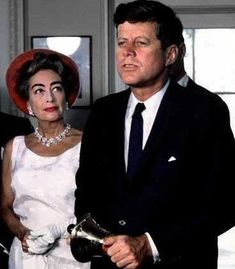 Joan Crawford in the Oval Office with President John F. Kennedy, May 3, 1963.
