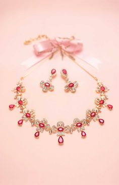 Gold diamond ruby set necklace earrings