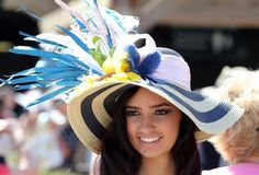 May 3, 2014; Louisville, KY, USA; Alley Jones wears a traditional derby hat before the 2014 Kentucky Derby at Churchill Downs. Mandatory Credit: Mark Zerof-USA TODAY Sports