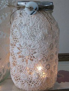 Elegance meets Southern Comfort!!  Think this could be done with lace fabric rather than doilies.  Could have colored ribbon in blue, black or purple...  Maybe a colored votive inside