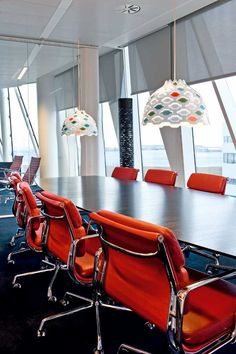 LC Shutters in colour hanging over a conference table at Saxobank.