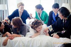 Four Seasons San Francisco-Doie Lounge bridesmaid robes  {ES Creations Photography}. This wedding party looks like they are having so much fun, pre-wedding.