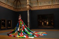 Dutch fashion designer Mattijs van Bergen and spatial designer Oeri van Woezik presented their Amsterdam Rainbow Dress in collaboration with COC Amsterdam. The dress, measuring over 50 ft, features the flag of the City of Amsterdam and the flags of 72 countries where 'homosexuality' is still punishable by law. The dress emphasizes the importance of openness and inclusivity that Amsterdam offers to LBGBTQI people