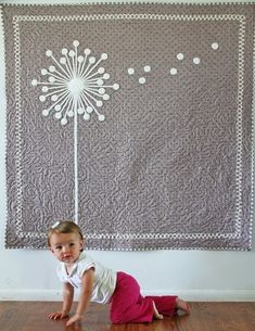 modern dandelion quilt, cute, simple. Instead of the busy background sewn pattern, straight lines on a diagonal?