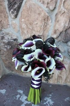 Bouquet...love the deep purple color inside the white. Do not like the black in the bouquet