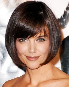 "Katie Holmes Kaite Holmes channeled her inner flapper, opting for a sleek, chin-length bob reminiscent of Louise Brooks's signature 'do in 2007. ""Katie's great bone structure means she can try a lot of different looks,"" said her hairstylist Andy LeCompte. The side-swept bangs give the otherwise traditional style a modern twist."