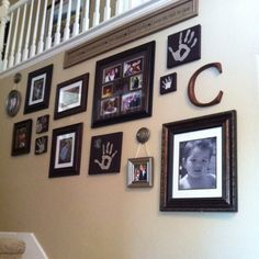 Super easy stairway decor! Small painted canvas for handprints and curtain rod finials for picture hangers. Easy!