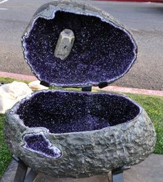 A giant amethyst geode container with it's own top (calcite growing inside).