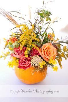 Pumpkin centerpiece for a Fall farm wedding for Tiffany and Dusty Sanford created by Celebrity Event Designer Scot Wedgeworth  www.scotwedgeworth.com