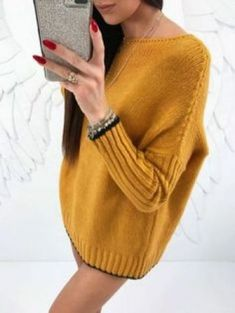 Free Knitting Pattern for Cedar Hill Pullover - This long-sleeved sweater features ribbed sleeves and high low hem with stockinette body and v-neck. 4 pieces. Uses US size 8 and 7 needles and 1215 yards of worsted weight yarn. Sizes S\/M (L\/XL, 1X\/2X). Designed by Michaels and Lion Brand.