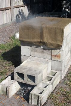 An excellent smoker can be built in no time by using standard concrete blocks. This is a fully functional and easy to operate smoker capable of producing smoked meats of the highest quality and it should not be judged by its looks. Build A Smoker, Diy Smoker, Bbq Pit Smoker, Homemade Smoker, Bbq Grill, Door Grill, Backyard Smokers, Outdoor Smoker, Outdoor Oven