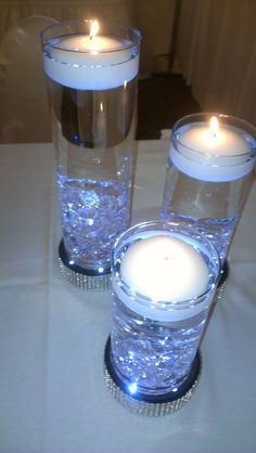Tiered floating candle set w/ base lighting