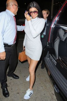 grey dress top x adidas sneakers x handbag. The youngest of the Kardashian sisters, and one of the hottest celebrities, Kylie Jenner. Look out Kim. Expect Instagram selfies, cute outfits, dope style, fashion, make up and hairstyles. Amazing body, beautiful clothes.