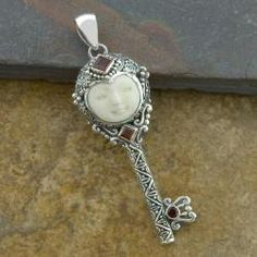 Sterling Silver Garnet 'Moon Princess' Cow Bone Key Pendant $59.49