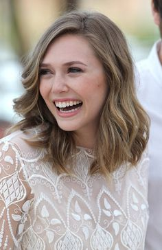 Thong Sandals Lookbook: Elizabeth Olsen wearing Thong Sandals (9 of 11). Elizabeth Olsen pared down her long lacy dress with black bow-adorned thong sandals.
