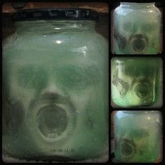 Cheap And Creepy Halloween Decorations:  Mask in a jar filled with green colored styling gel.