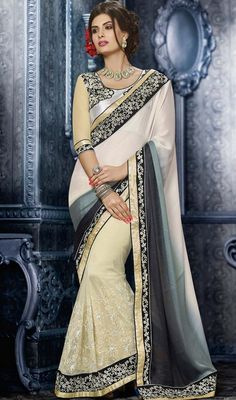Add a small burst of colour for any wardrobe with this slate gray & cosmic latte crepe silk saree. The ethnic lace & resham work at the clothing adds a sign of attractiveness statement with your look. #latestsareedesigns #newdesignsaree #onlineshadedsaris