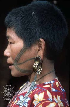 The Konyak woman's facial tattoos below are similar to Laju Naga of Arunachal / Myanmar. Here's a photo I took of a Laju woman near Khonsa, 2008. I also like the ingenious use of a watch wristband attached to her coin earrings.