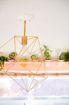 Hanging gold geometric light (and those cute plants!!)