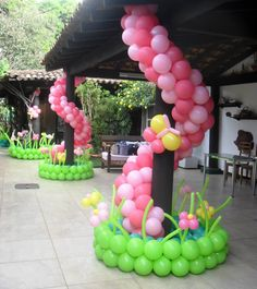 Wrap around pink balloons for porch pillars.just because my brother really liked the idea but in a different color of course