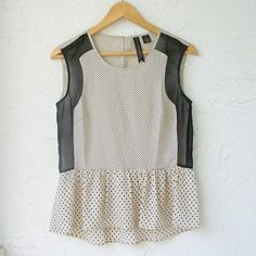 """*NWT* Polka Dot Peplum Top. Casual street style ❤️ BUNDLES  ❤️ DISCOUNTS  ❌ NO TRADES  ❌ NO LOW-BALLING   *NEW WITH TAGS* Polka Dot Peplum Top   Complete your casual street style outfit with this cute chic top. Beautiful black Chiffon Detail on the sides. Falls Longer at the back. Please read measurements.  Fabric: 100% polyester  MEASUREMENTS (garment Lying flat): Size S Length front: 22.25"""" Length back: 25"""" Bust: 34.5"""" Tops"""