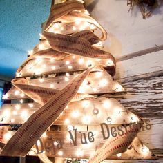 Pallet Christmas Tree: 10 Tutorials and Christmas Decorating Ideas - See all 10: http://www.familyhandyman.com/smart-homeowner/10-tutorials-and-christmas-decorating-ideas