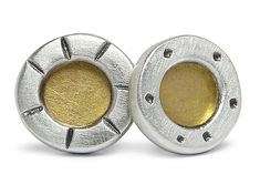 Silver Studs with Gold Center by Jodi Brownstein. Sterling silver stud earrings with 18k gold bimetal centers. Stamped with dots and line details that are oxidized to bring out the details. Matte finish.