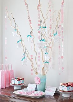 make a wish birthday party - love the decorations (festooned branches in lovely vase; cake plates used for party favors; confetti on table; party bags