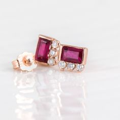 Solid 14k rose gold pink ruby baguette stud earrings with three white diamonds by Melanie Casey Jewelry.