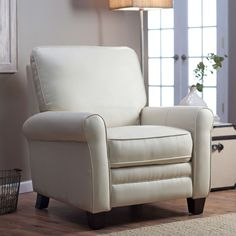 At first glance, this Soft Cream Bonded Leather Upholstered Club Chair Recliner with Espresso Legs doesn't appear to be a recliner at all. Its sleek transitional style paired with its smooth, creamy b