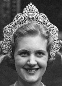 Tiara Mania: Duchess of Westminster's Halo Diamond Tiara worn by a Sotheby's employee
