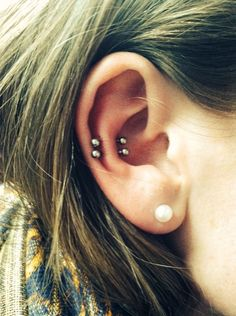 A friend of mine's Double Snug piercing. This is what I want mine to look like!
