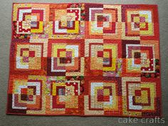 Modified Bento Box from A Bright Corner. Also check out the version in blue. Scrappy Quilt Patterns, Scrappy Quilts, Quilt Blocks, Dinosaur Fabric, Bright Quilts, Log Cabin Quilts, Log Cabins, Straight Line Quilting, Quilt Modernen