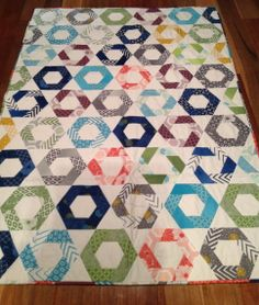 I made this quilt for the 2014 Rosehill Stitches and Craft Show. Using a pattern called Snacktime and the amazing Hex N More ruler from Jaybird Quilts. This is a lap size quilt and used 1 Jelly Roll. I used ALL the scraps for the binding.    The pattern is available from my online store for AUD $15.