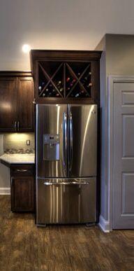 Wine rack above refrigerator