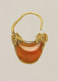 Gold and carnelian boat-shaped earring  Period: Classical Date: 5th–4th century B.C. Culture: Greek Medium: Gold, carnelian
