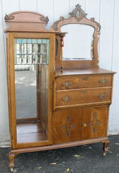 Tall oak china server with Leaded glass.