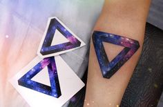 Space style impossible triangle tattoo by Anna Yershova