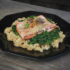 #garlic #baked #wildcaught #salmon with #organic power greens @ebfarm and #cauliflowerrice  #paleo #primal #eatclean #cleaneating #cleaneats #glutenfree #DairyFree #grainfree #lowcarb #highprotein #fitstagram #fitfam #healthyliving #healthy #nutrition #realfood #nourish #instafood #foodstagram #food #nomnom #sustainable by piyuthai