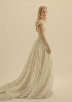 A gauzy silk ballgown with cap sleeves. #wedding #dress #sleeves