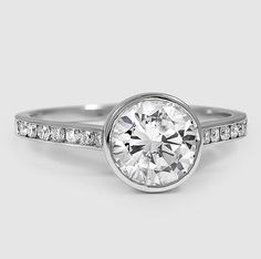 The dazzling band in this white gold setting is set with lustrous channel set diamonds that add a sublime sparkle.