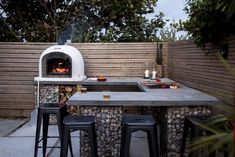Outdoor Kitchen with huge Pizza Oven and Gas BBQ. Our record for cooking 14 pizz… Outdoor Kitchen with huge Pizza Oven and Gas BBQ. Our record for cooking 14 pizzas is 7 minutes! Outdoor Bbq Kitchen, Pizza Oven Outdoor, Outdoor Kitchen Design, Outdoor Kitchens, Home Pizza Oven, Outdoor Grill Area, Outdoor Cooking Area, Outdoor Bars, Outdoor Rooms
