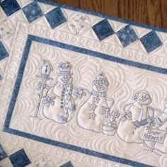 A Line up of 5 Smiling Snowmen Pose as They Wait for the Snow to Fly! A FUN BlueWork Table Runner to Decorate Your Home for the Holidays and ALL Throughout Winter.