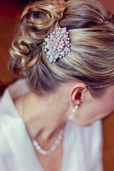 Curled Bridal Updo - with a perfectly placed accessory! love the accessory and hair.