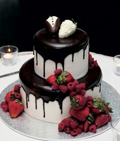 This cake makes us lick our lips and the cake toppers are adorable! - Chocolate & Strawberries #wedding #cake